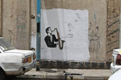 """Mural by the artist: Hakim Alrudaini """"Sounds of peace"""" Ruins campaign, 14th May 2017."""